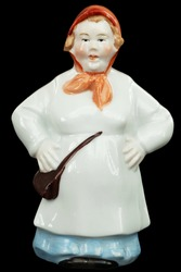 Porcelain figurine of a woman, the fisherman's wife, isolated on black background