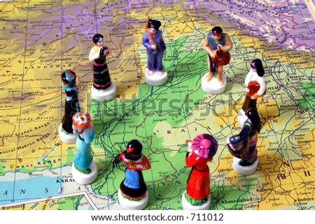 Porcelain figurines on map, representing people of the world.
