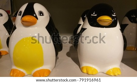 Porcelain- made cute little penguins can be used as decorative items to the homes as well as souvenirs to your dear ones #791916961