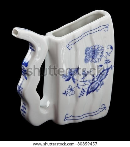 porcelain mug for drinking mineral water on a black background. - stock photo
