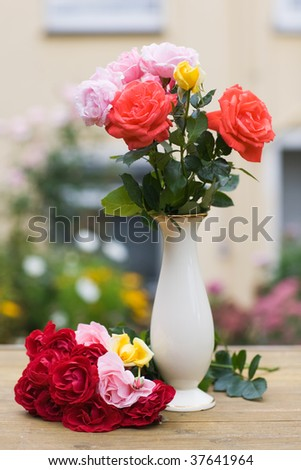 Porcelain pot with colorful roses