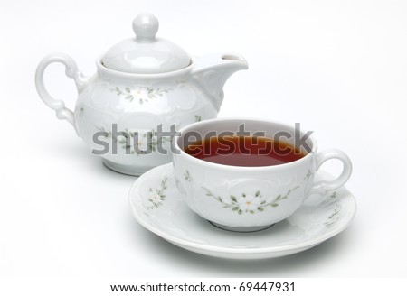 Porcelain teapot and teacup isolated on white background