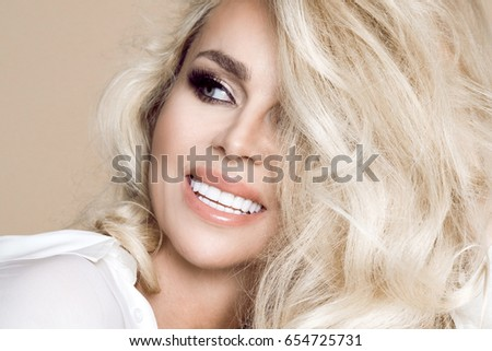 Porcelain veneers. Pretty female model with perfect smile. Young beautiful woman with beautiful white teeth. Teeth whitening. Perfect smile.