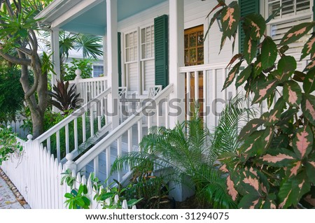 porch and picket fence along quiet side street in key west florida