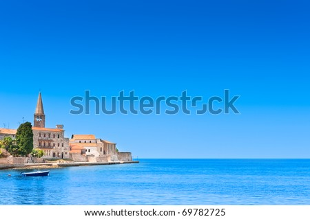 Porec old town in Croatia, Adriatic coast, Istria region, popular touristic destination. Copyspace on blue sky.