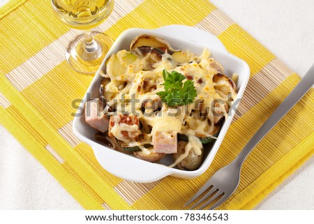 Pork and potato casserole topped with cheese