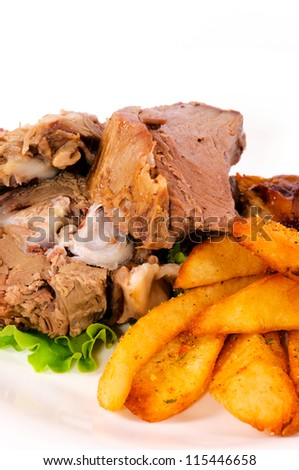 Pork and potato on the plate - stock photo