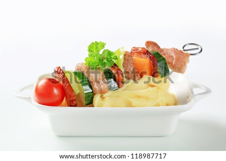 Pork and vegetable skewer with mashed potato