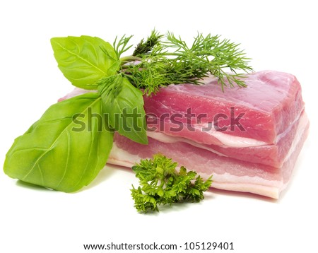 Pork belly with herbs spices on a white background
