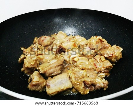 Pork bone fried with garlic pepper, frying Chevron pan. #715683568