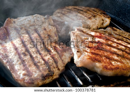 Pork chop grilled with delicious toasted traces and fragrant smoke