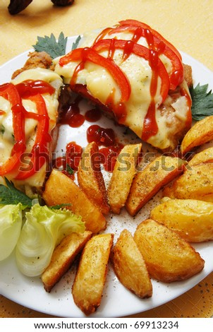 pork chop with cheese and roasted potatoes