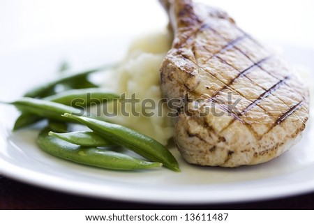 Pork Chop with green beans and mashed potatoes
