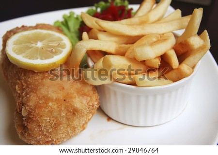 Pork cordon blue on plate with fries and salad