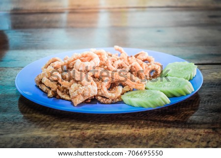 pork crackling, It can also be fried or roasted in pork fat as a snack. The frying renders much of the fat that is attached to the uncooked rind. #706695550