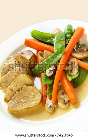 Pork fillet with a mustard sauce, and a melange of vegetables including snow peas, baby carrots and mushrooms.