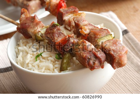 Pork kebabs with rice in a bowl