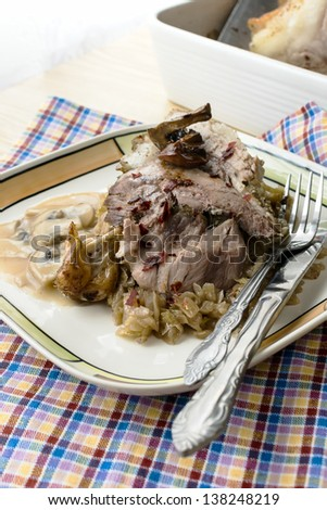 Pork knuckle with sauerkraut and mushroom sauce