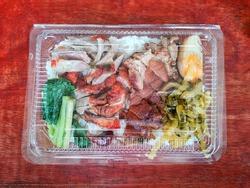 Pork leg in rice in plastic box