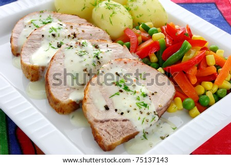 Pork meat with vegetables and sauce