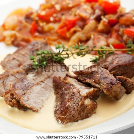 Pork Medallions with Beans and Sauce - stock photo