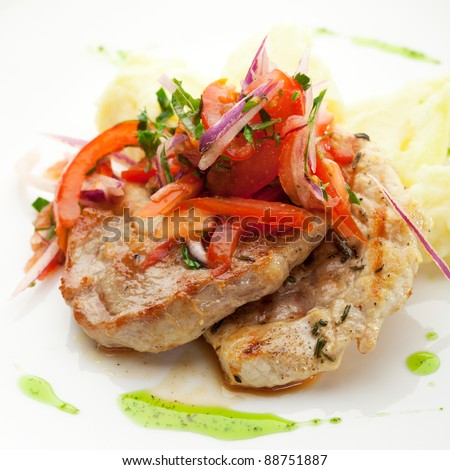 Pork Medallions with Mushed Potato and Salsa Sauce - stock photo