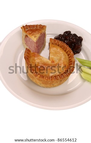 Pork pie with spring onions and brown pickle