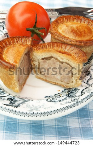 Pork pies in a picnic setting - stock photo