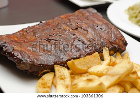 Pork ribs back with french fries