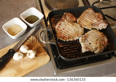 Pork ribs grilling in house kitchen