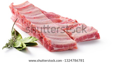 Pork ribs. Raw meat on a white background Foto stock ©