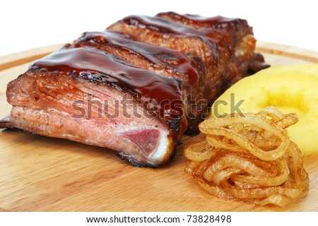 pork ribs with fried onions and apples barbecue
