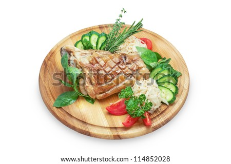 pork shank on a wooden platter isolated on white background