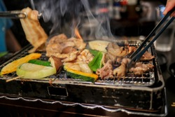 Pork slice, pork belly and vegetables grilled or Babecue and smoke from grilled