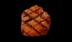 Pork steak isolated on black background,Jack food,BBQ,sauce,grill,burn,black,Grilled pork steak isolated on black background