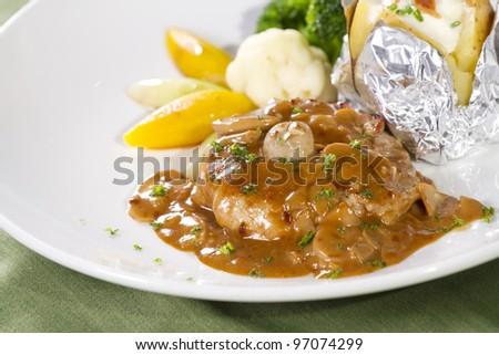 pork steak, pork steak with brown pepper sauce and sides