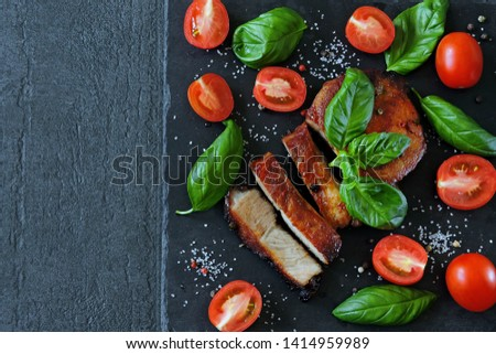 Pork steak with basil and tomatoes. Keto diet. Paleo diet. Pegan Diet.