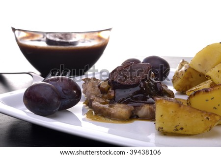 Pork steak with sauce of prunes, cranberries, almonds and bacon - stock photo