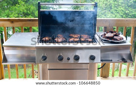 Pork steaks on gas grill
