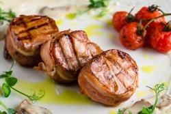 Pork tenderloin medallions, beef medallions close-up