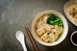 pork wonton soup or pork dumplings soup with vegetable - Asian food style
