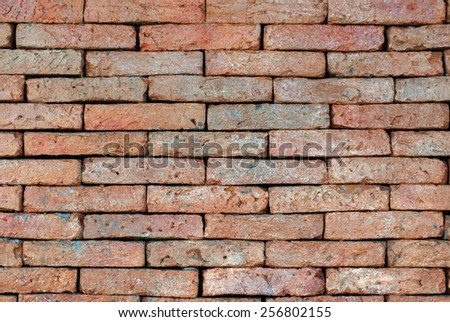 Porous red bricklaying without filling with cement, background