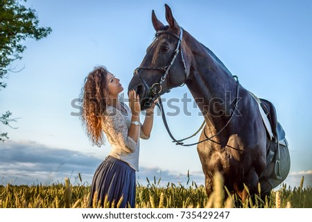 Stock Photo porportrait of the young beautiful girl with a horse in the fieldtrait of the young beautiful girl with a horse in the field