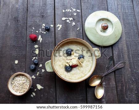 Porridge, berries, selective focus and toned image #599987156
