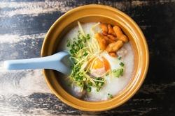 Porridge, eggs on a wooden table