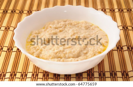 porridge in white bowl with butter