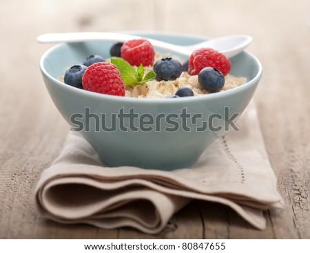 porridge with fresh berries - stock photo