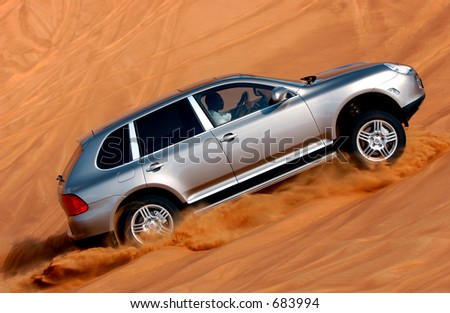 Porsche Cayenne in the Deserts of Dubai