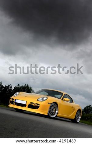 porsche cayman with a stormy sky