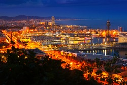 Port and cityspace of Barcelona in evening